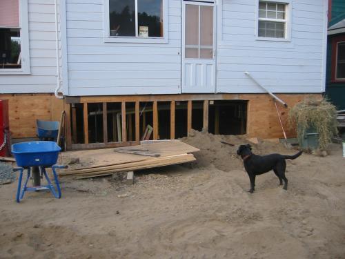dirt against house