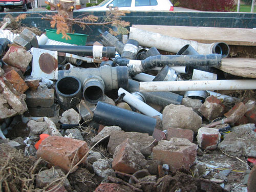Old pipes in dumpster