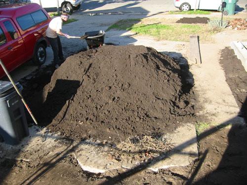 Shovelling compost