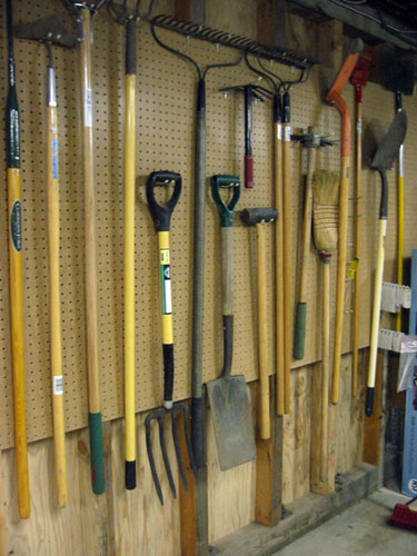 Garden tools on pegboard
