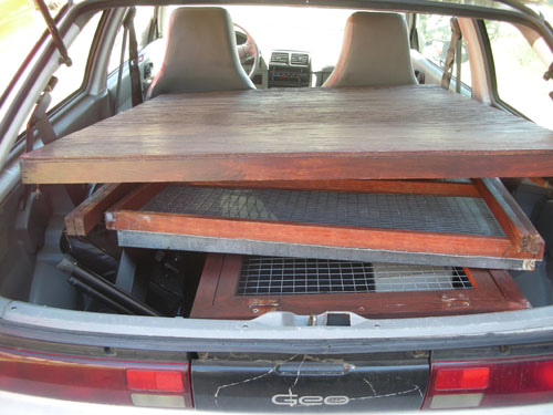 Rabbit hutch in the back seat of the Geo