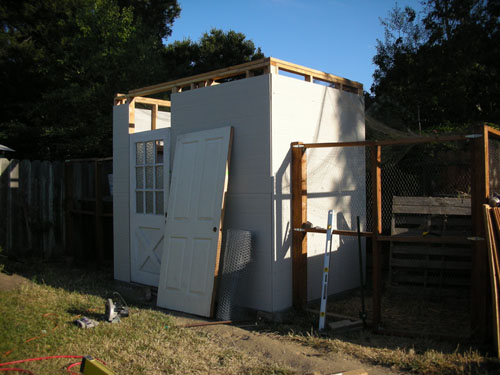 Chicken house with door and siding