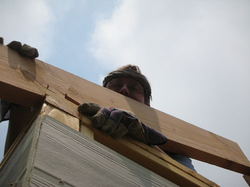 Putting a rafter in place