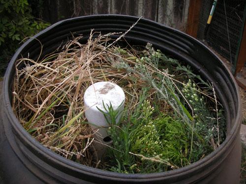 Filled compost tumbler