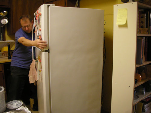 Noel moves the fridge