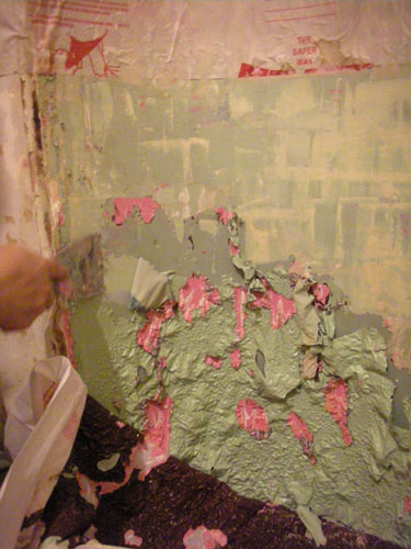 Paint peeling away from the niche
