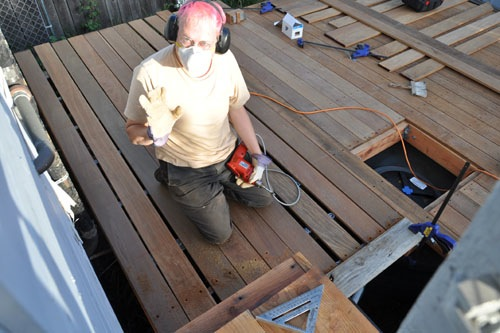 Putting boards down on the other side of the deck