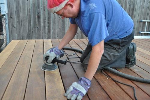 Noel sanding the deck
