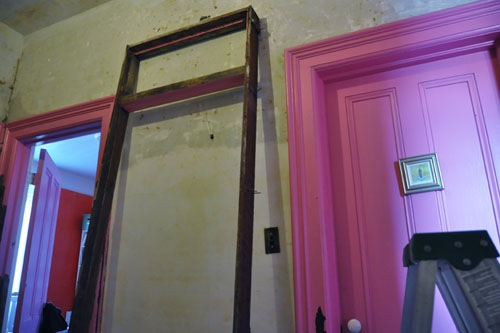 The door frame out and leaning against the hall wall