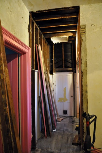 The plaster over the door cut out, and framing removed
