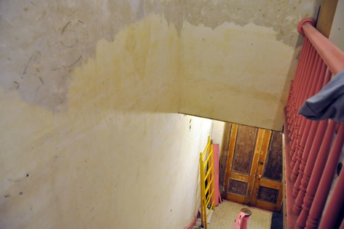 Paint removed above the stairs