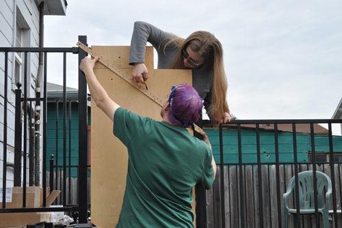 Jenifer helps Noel draw the line