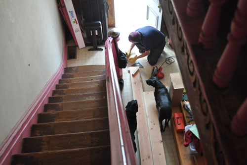 Cutting wood in the front hall