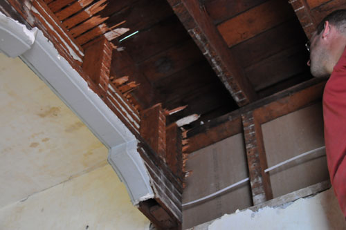 How to securely attach framing to this old house