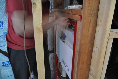 Reinstalling the toilet tank