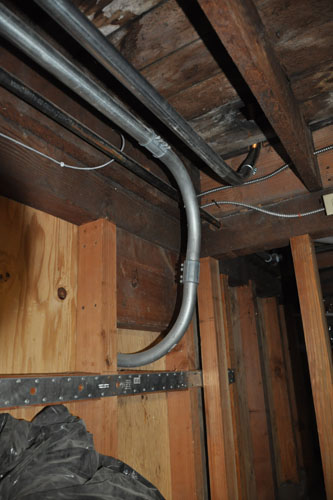 Conduit running to the basement subpanel and upstairs