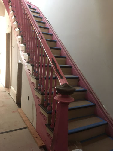 Front stair handrail in place