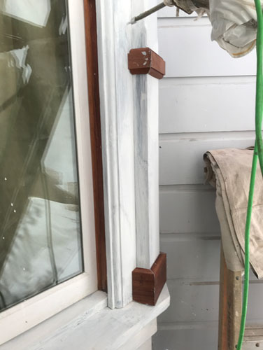 Adding trim pieces on at the kitchen bay window