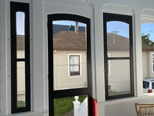 screen porch with a few of the screens in place