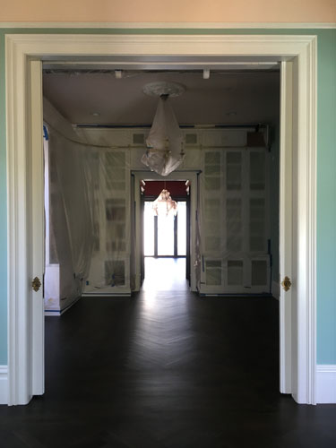 Facing the back of the house through the parlours