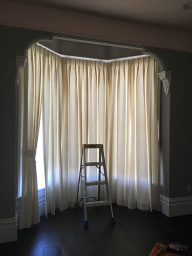 Very basic curtains in the front bedroom
